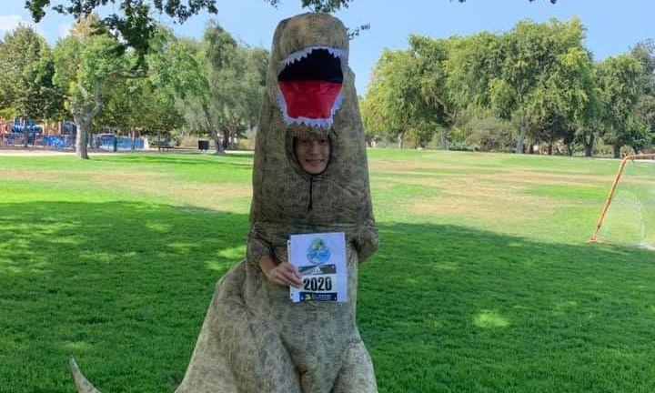 Around Town: Avid runner trots through Pardee Park in dinosaur costume