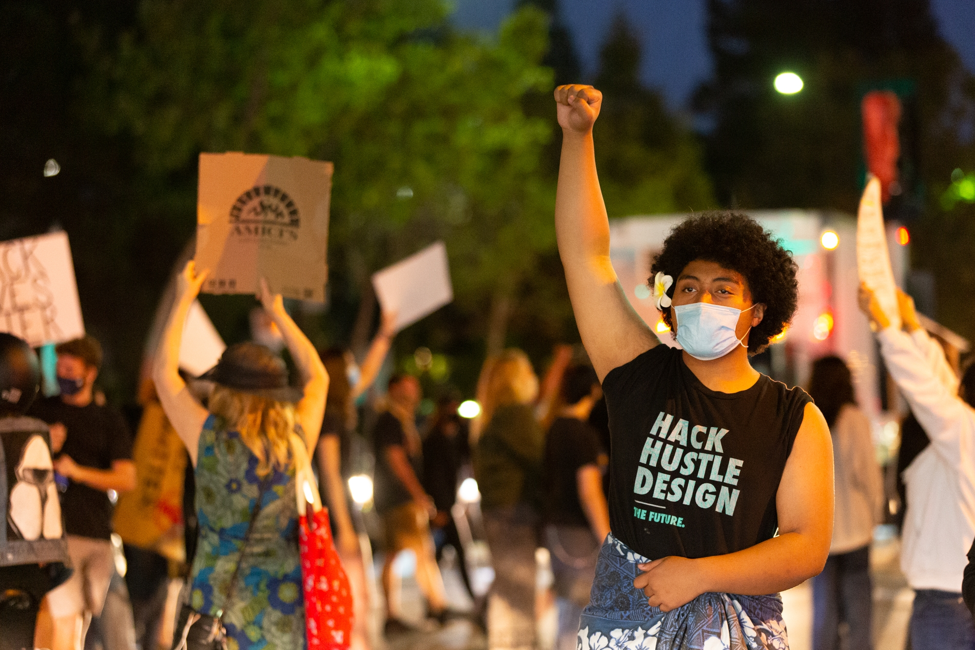 Protester demanding justice for Breonna Taylor stop traffic in Menlo Park